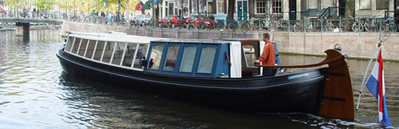 Canal barge Jacob van Lennep Amsterdam