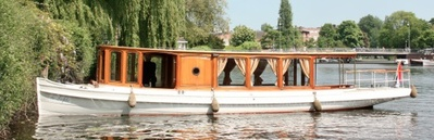 Canal boat De Liefde Amsterdam